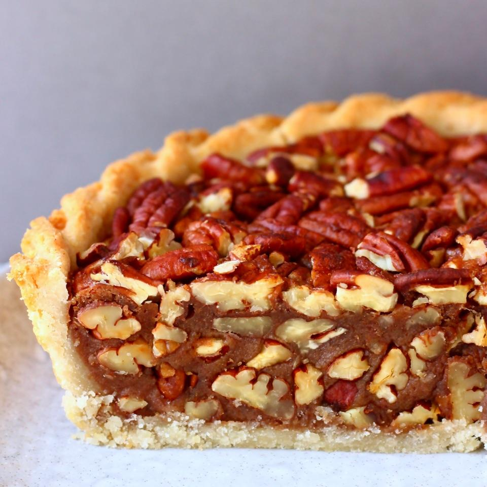This Gluten-Free Vegan Pecan Pie has a crispy, buttery crust and a fudgy, gooey filling and is loaded with toasty pecans. Also refined sugar free.