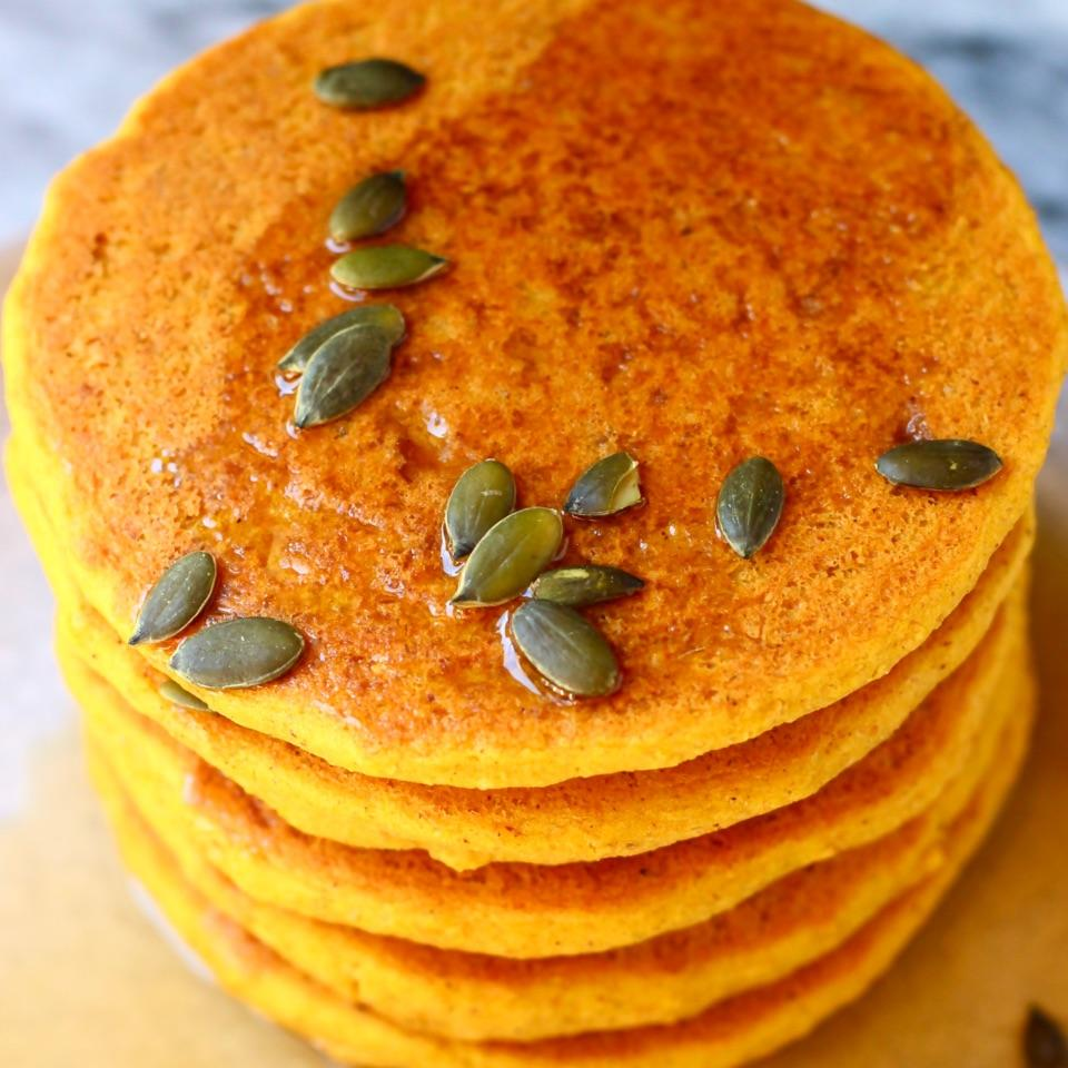 These Gluten-Free Vegan Pumpkin Pancakes are moist and fluffy, subtly spiced and perfectly satisfying! They're refined sugar free (or can be made with no added sugar) too.